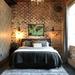 Ispirazione per una camera da letto industriale con pareti rosse, pavimento in cemento e pavimento nero