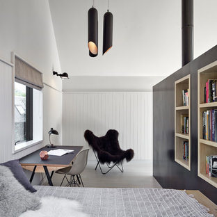 Inspiration for a medium sized contemporary guest bedroom in London with light hardwood flooring, grey floors and white walls.