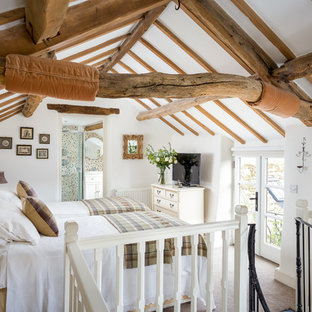 This is an example of a small country mezzanine bedroom in Gloucestershire with white walls and carpet.