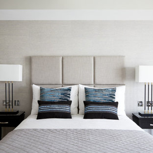 Design ideas for a large contemporary master bedroom in London with grey walls, medium hardwood flooring, a vaulted ceiling and wallpapered walls.