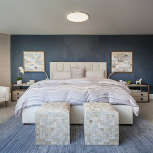 Inspiration for a large contemporary ceramic floor and beige floor bedroom remodel in Miami with blue walls and no fireplace
