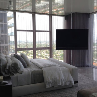 Mid-sized modern master bedroom in Miami with grey walls, marble floors and no fireplace.