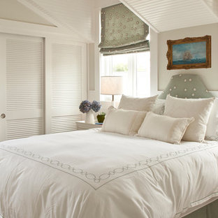 Coastal bedroom photo in Orange County with gray walls and no fireplace