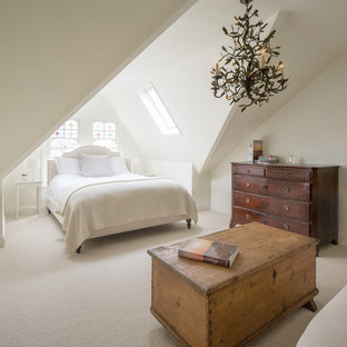This is an example of a medium sized classic guest bedroom in London with carpet, beige floors, white walls and no fireplace.
