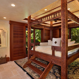 Bedroom - large tropical travertine floor and beige floor bedroom idea in Hawaii with beige walls and no fireplace
