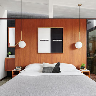 Example of a small trendy master concrete floor and gray floor bedroom design in San Francisco with brown walls