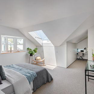 Design ideas for a contemporary bedroom in Sydney with white walls, carpet and grey floor.