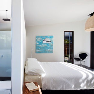 Inspiration for a modern bedroom remodel in Melbourne with white walls