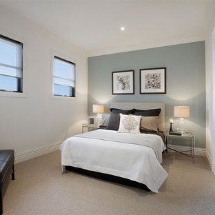 Photo Of A Medium Sized Traditional Guest Bedroom In Melbourne With Blue Walls Carpet And