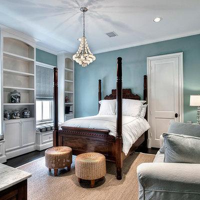 Elegant bedroom photo in Houston with blue walls