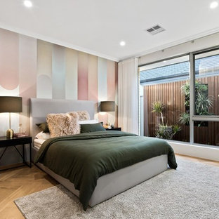 This is an example of a mid-sized contemporary master bedroom in Perth with medium hardwood floors and beige floor.