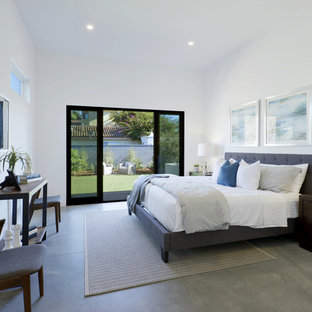 Trendy master concrete floor and gray floor bedroom photo in Los Angeles with white walls