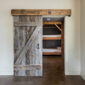 Barn Door Entry to Bunkroom - Blalock Lakes Custom Homes by Winans Homes