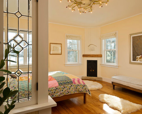 Country Bedroom Photo In New York With A Corner Fireplace