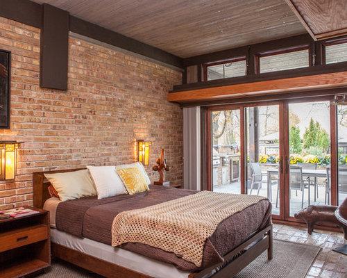 Chambre avec un sol en brique et un mur marron : Photos et idées ...