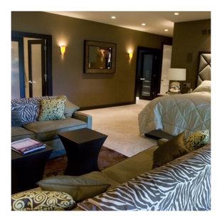 Large transitional master limestone floor bedroom photo in Chicago with brown walls