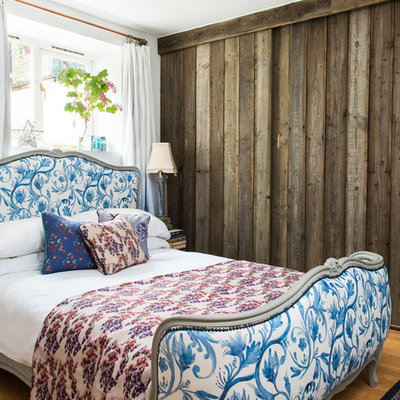 Example of a classic light wood floor bedroom design in London with white walls