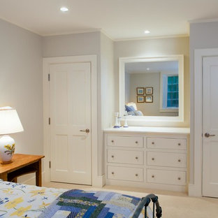 Example of a large beach style carpeted bedroom design in Boston with white walls and no fireplace