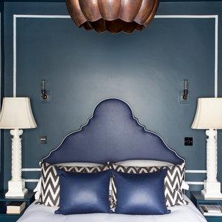Bedroom - eclectic bedroom idea in London with blue walls