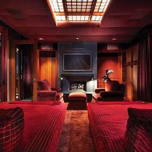 На фото: спальня среднего размера в стиле современная классика с коричневыми стенами, темным паркетным полом, стандартным камином, фасадом камина из бетона и коричневым полом с