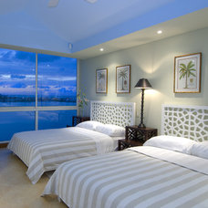 Tropical Bedroom by Jerry Jacobs Design, Inc.