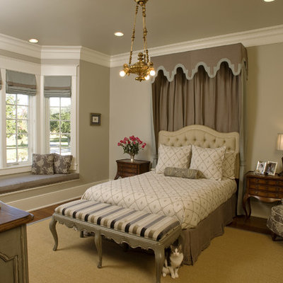 Inspiration for a large timeless master dark wood floor bedroom remodel in New Orleans with beige walls and no fireplace