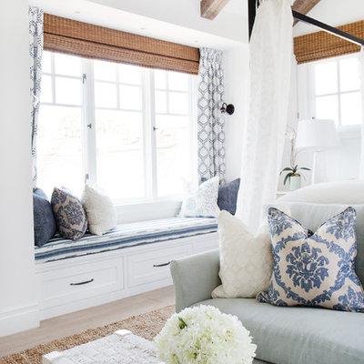 Bedroom - mid-sized coastal master light wood floor bedroom idea in Orange County with white walls