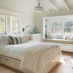 Inspiration for a rural bedroom in Boston with grey walls and light hardwood flooring.