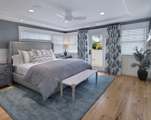 Example Of A Mid Sized Coastal Master Light Wood Floor Bedroom Design In  San Diego