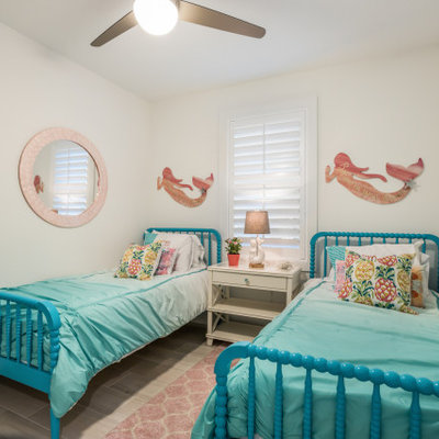 Example of a beach style bedroom design in Tampa with white walls