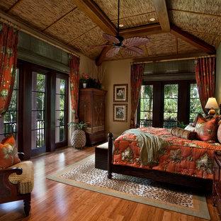 Bedroom - tropical bedroom idea in Miami with green walls