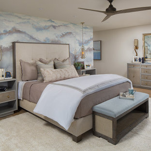 Inspiration for a mid-sized coastal master beige floor and light wood floor bedroom remodel in Orange County with multicolored walls