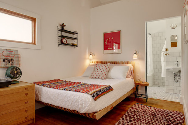 Eclectic Bedroom by Blue Sound Construction, Inc.