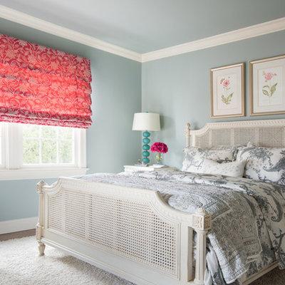 Bedroom - mid-sized traditional guest dark wood floor and brown floor bedroom idea in New York with blue walls