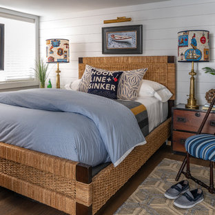 Photo of a small beach style bedroom in Boston with grey walls, no fireplace and dark hardwood floors.