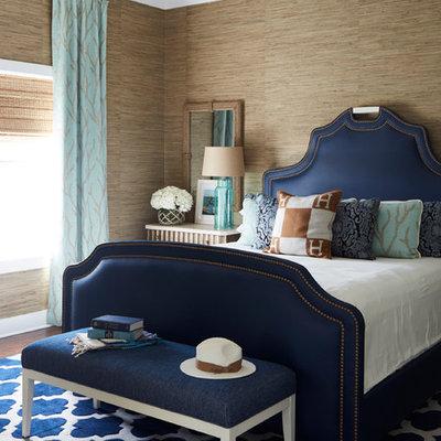 Inspiration for a mid-sized coastal dark wood floor and brown floor bedroom remodel in Atlanta with beige walls