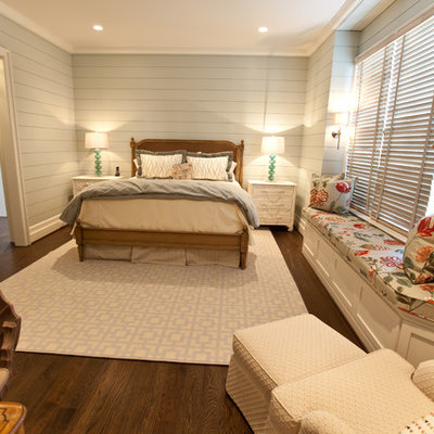 Example of a beach style dark wood floor bedroom design in Raleigh with gray walls
