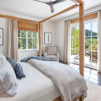 Bedroom - large coastal master dark wood floor and brown floor bedroom idea in San Francisco with no fireplace and white walls