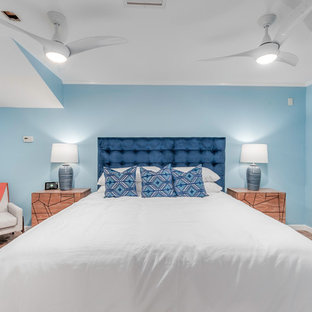 Design ideas for a beach style bedroom in Tampa with blue walls and red floor.