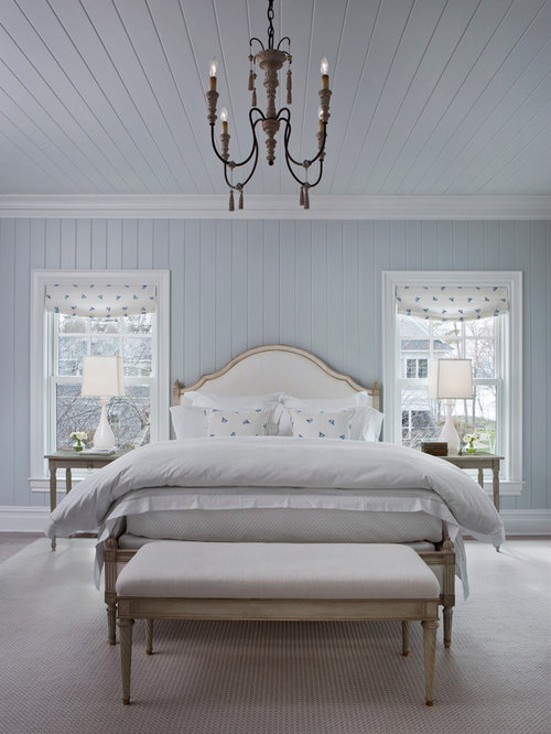 inspiration for a large beach style gray floor bedroom remodel in other with blue walls - Blue And White Bedroom Pictures