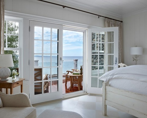 Example of a coastal painted wood floor and multicolored floor bedroom  design in Other with white