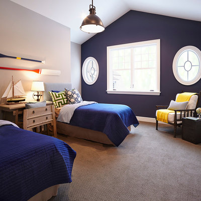 Large beach style guest carpeted bedroom photo in Minneapolis with blue walls and no fireplace