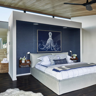 Inspiration for a coastal dark wood floor bedroom remodel in New York