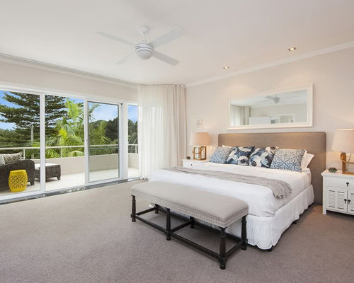 Beach Style Bedroom Design Ideas  Renovations   Photos Inspiration for a beach style bedroom in Sydney with beige walls  carpet  and no fireplace. Beach Style Bedroom. Home Design Ideas