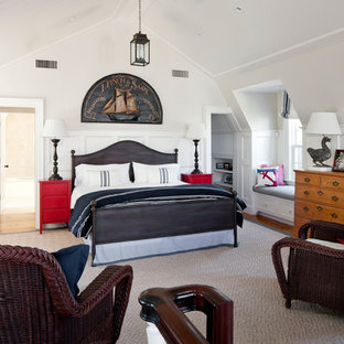 Example of a coastal bedroom design in Boston with white walls