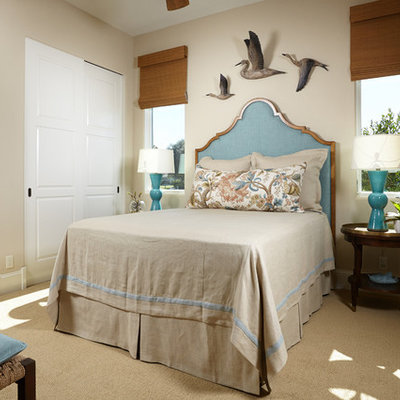 Example of a beach style carpeted bedroom design in Miami with beige walls