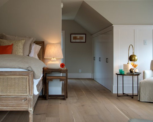 Example Of A Coastal Bedroom Design In Boston With Beige Walls And Medium Tone Wood Floors