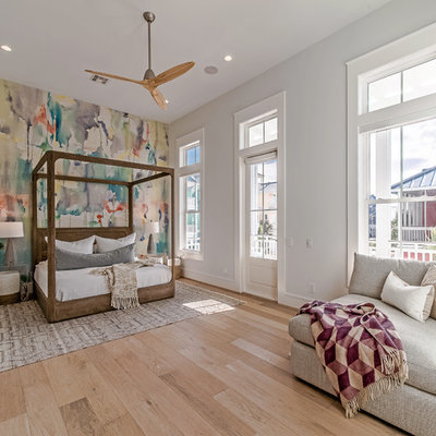 Beach style light wood floor bedroom photo in Houston with multicolored walls