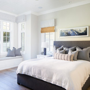 Bedroom - beach style guest medium tone wood floor and brown floor bedroom idea in Orange County with gray walls