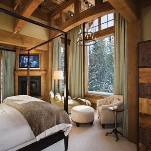 Réalisation d'une chambre tradition avec une cheminée d'angle.